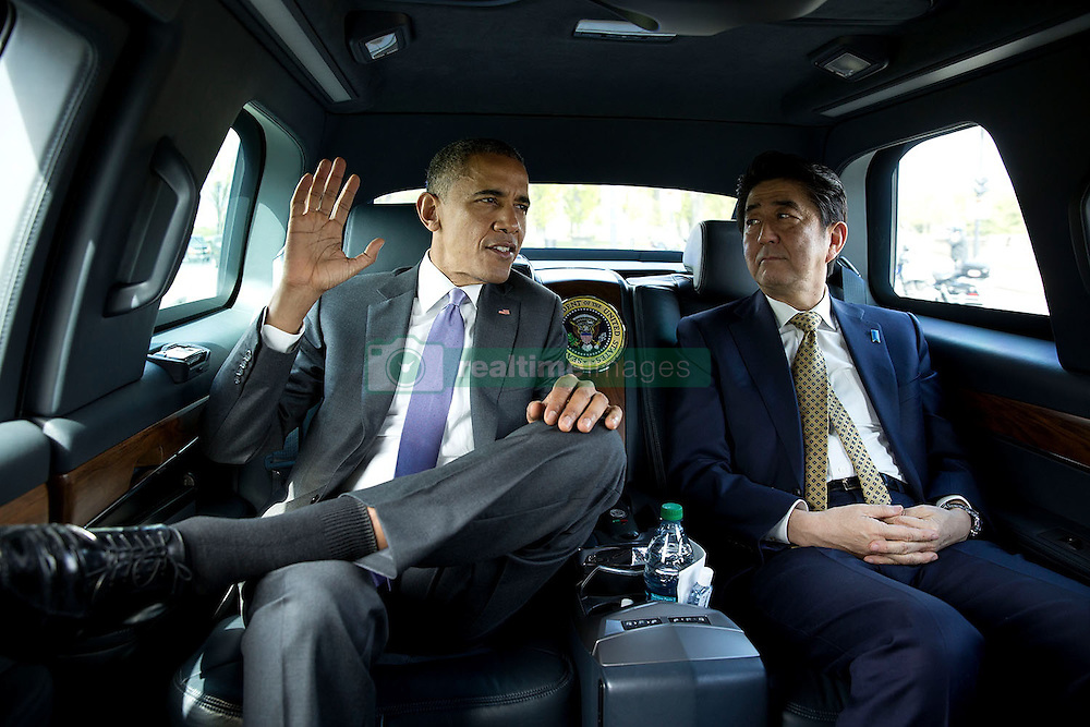 President Barack Obama and Prime Minister Shinzo Abe of Japan travel by motorcade to the Lincoln Memorial in Washington, D.C., April 27, 2015. (Official White House Photo by Pete Souza)<br /> <br /> This official White House photograph is being made available only for publication by news organizations and/or for personal use printing by the subject(s) of the photograph. The photograph may not be manipulated in any way and may not be used in commercial or political materials, advertisements, emails, products, promotions that in any way suggests approval or endorsement of the President, the First Family, or the White House.