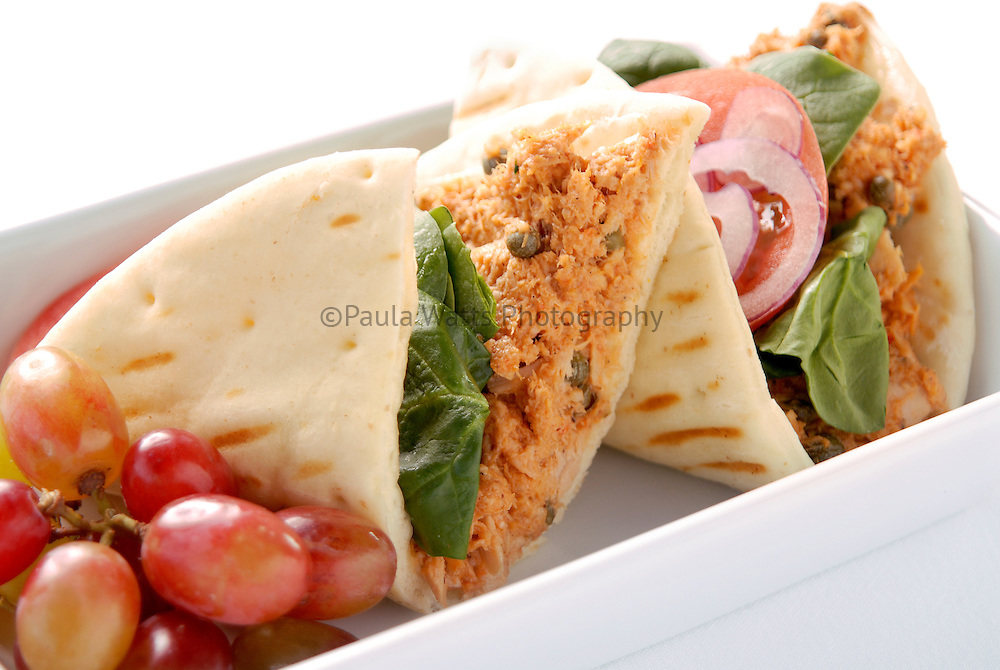 Healthy lunch option tuna and pita wrap with fruit