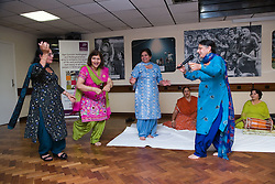 Traditional performance by a group of Asian ladies at Age Concern local talent show,
