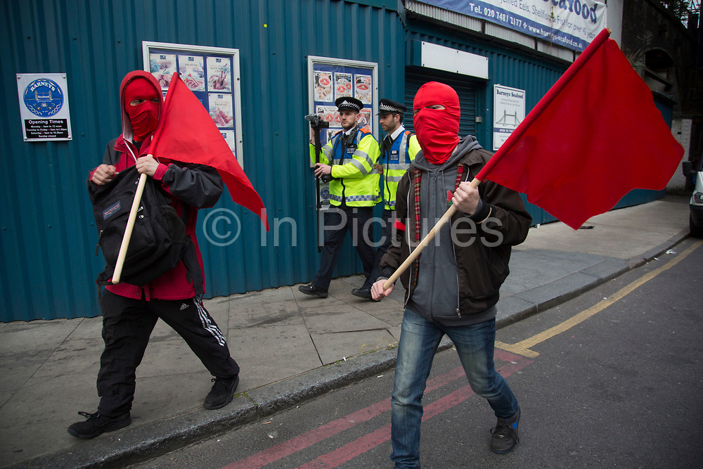 Anarchists gather as a black bloc for the Fuck Parade to party and protest at the class and wealth divide between rich and poor and the gentrification of London, the demonstration was organised by anarchist group Class War on May 1st 2016 in London, United Kingdom. The parade is now part of the May Day activism calendar as dissatisfaction about the establishment, the police and the inadequacy of the press is highlighted. (photo by Mike Kemp/In Pictures via Getty Images)