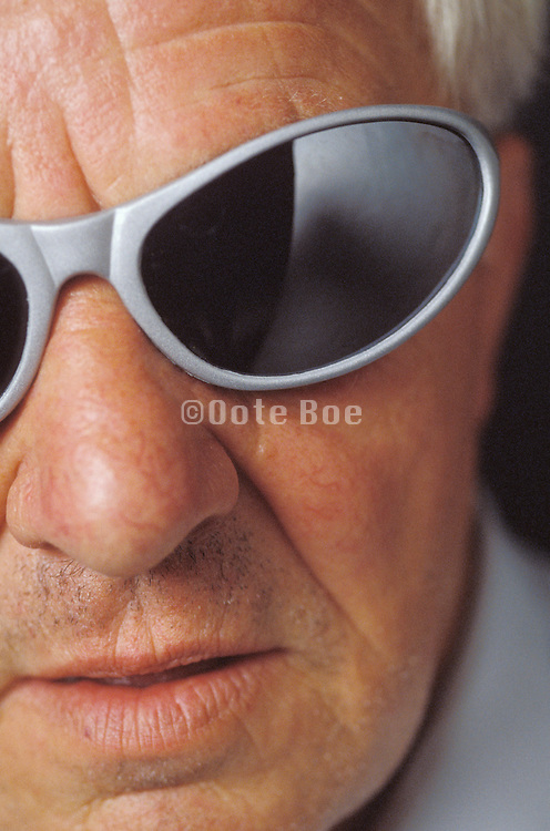 Old man wearing tough looking plastic sunglasses