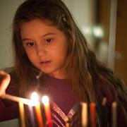 Lighting Chanukah candles.