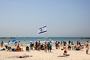 People on the beach of the in Tel-Aviv, Israel April 15, 2021. People gathered in their masses at Tel-Aviv's shore line as the Jewish state celebrates 73 years to it's establishment. As vast percentage of the population are vaccinated, celebrations were able to take place in a some what ordinary manner.Starting Sunday April 18, 2021, it will no longer be mandatory to wear a protective mask in open spaces throughout the country.