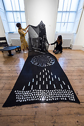 "© Licensed to London News Pictures. 08/10/2020. LONDON, UK. Staff members present ""Astral Sea III"", 2019, by Tsedeye Makonnen.  Preview of 1-54 Contemporary African Art Fair, the leading international art fair dedicated to contemporary art from Africa and its diaspora, taking place at Somerset House.  The fair showcases the work of more than 110 emerging and established artists from Africa and is the only physical art fair taking place during Frieze Week.  Photo credit: Stephen Chung/LNP"