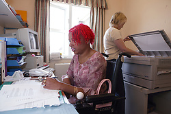 Young woman with disability working in an office,