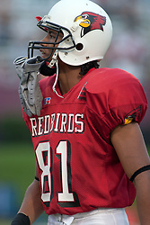 24 SEP 2005<br /> <br /> Wide Receiver Laurent Robinson of the Illinois State Redbirds walks the sidelines during pre-game warm ups.<br /> <br /> The Illinois State University Redbirds are victorious with a shut out score of 42 - 0 over Murray State Racers during the Hall of Fame Game held at Hancock Stadium on Illinois State University campus in Normal IL