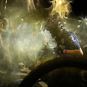 CHARLOTTE, NC - August 24:  Pepper spray is deployed to disperse a group of protestors, organized by Charlotte Uprising, as they clash with Charlotte-Mecklenburg police for a third night in a row as they march through uptown Charlotte near the site of the 2020 Republican National Convention in uptown Charlotte on August 24, 2020. The group, organized by Charlotte Uprising is protesting the existence of the convention in Charlotte, the policies of the Trump administration and the the abolishment of police and prisons. Delegates are holding private meetings inside the convention center ahead of the official start of the paired down convention on August 24th. (Photo by Logan Cyrus for AFP)