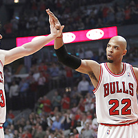 14 March 2012: Chicago Bulls center Omer Asik (3) is congratulated by Chicago Bulls forward Taj Gibson (22) during the Chicago Bulls 106-102 victory over the Miami Heat at the United Center, Chicago, Illinois, USA.