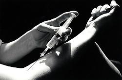 Drug user taking heroin, UK 1989