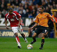 Photo: Steve Bond/Sportsbeat Images.<br /> Wolverhampton Wanderers v Bristol City. Coca Cola Championship. 03/11/2007. Karl Henry (R) lays the ball off as Marvin Elliott (L) closes in