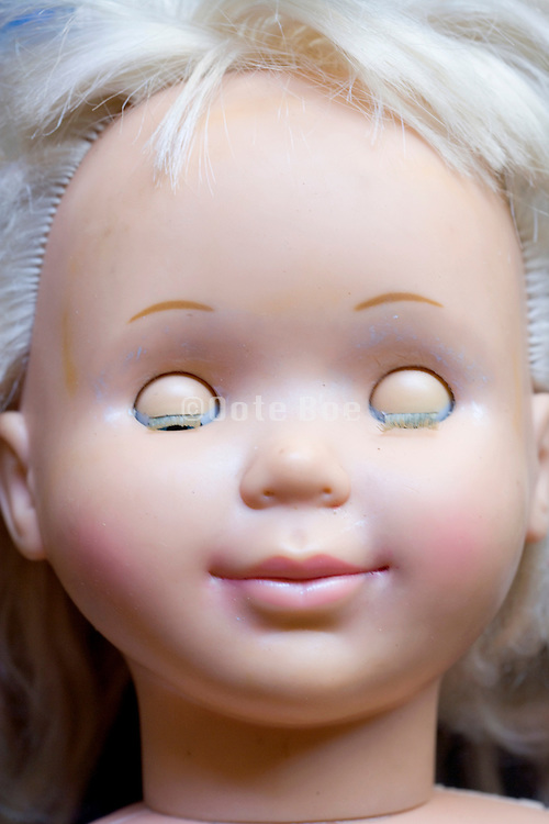 doll head with closed eyes