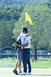 July 8, 2018 - White Sulphur Springs, WV, U.S. - WHITE SULPHUR SPRINGS, WV - JULY 08: Kevin Na hugs his caddie on the 18th green during the final round of the Military Tribute at the Greenbrier in White Sulphur Springs, WV, on July 8, 2018.(Photo by Brian Bishop/Icon Sportswire) (Credit Image: © Brian Bishop/Icon SMI via ZUMA Press)