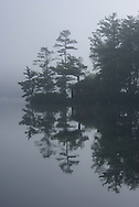 An early morning mist on Lake Winnipesaukee in New Hampshire added to the etheral feel of this scene.