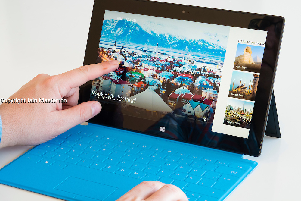 Reading Bing travel article on a Microsoft Surface rt tablet computer