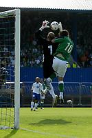 Photo: Andrew Unwin.<br />Northern Ireland v Azerbaijan. FIFA World Cup Qualifying match. 03/09/2005.<br />Northern Ireland's James Quinn (R) clatters into the Azerbaijan goalkeeper, Dmitri Kramarenko (L).