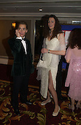 Dominick Ruck-Keene and Georgie Cole. White Knights Ball, Grosvenor House. Park Lane. London. 6  January 2006. ONE TIME USE ONLY - DO NOT ARCHIVE  © Copyright Photograph by Dafydd Jones 66 Stockwell Park Rd. London SW9 0DA Tel 020 7733 0108 www.dafjones.com