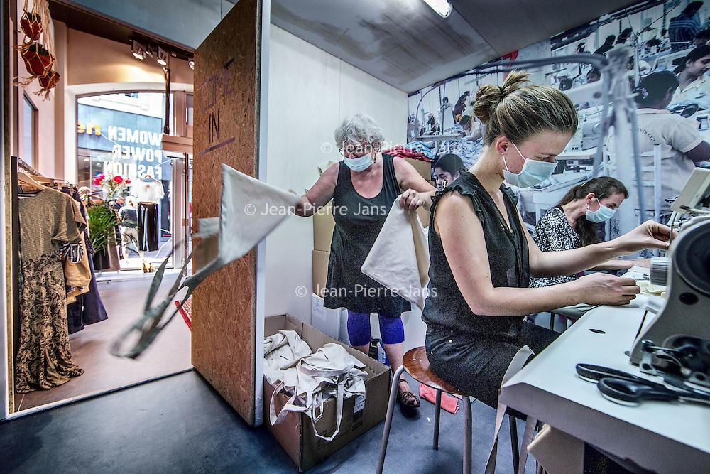 """Nederland, Amsterdam, 11 mei 2016.<br /> Sweatshop is de populaire benaming voor een naaiatelier waarin arbeiders in landen als Bangladesh en India kleding maken onder erbarmelijke omstandigheden. Op woensdag 11 mei opent er een heuse sweatshop in de Kalverstraat in Amsterdam. Door een sweatshop na te bootsen, wil Schone Kleren Campagne mensen in Nederland laten ervaren hoe de laaggeprijsde kleding die in diezelfde winkelstraat te koop is, wordt gemaakt. De fabriek ligt verscholen aan de andere kant van een pashokje in de hippe conceptstore 'The Mad Rush' op Kalverstraat nummer 101 en is vanaf 11 mei tot en met zondag 15 mei 2016 te bezoeken. <br /> <br /> Sweatshop is a popular term for a sewing workshop in which workers in countries such as Bangladesh and India make clothes under appalling conditions. On Wednesday, May 11th will open a real sweatshop in the Kalverstraat in Amsterdam. By mimicking a sweatshop Clean Clothes Campaign wants people to experience how the low-priced clothing that is for sale in the same shopping street, is made in the Netherlands. The factory is to visit hidden on the other side of the dressing room in the fashionable concept store """"The Mad Rush"""" on Kalverstraat number 101 and from 11 May to Sunday, May 15th, 2016.<br /> <br /> Foto: Jean-Pierre Jans"""