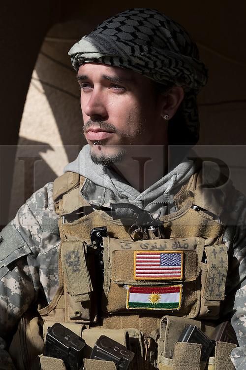 © Licensed to London News Pictures. 19/02/2015. Dohuk, Iraq. A portrait of Brett, an American volunteer fighter serving with the Dwekh Nawsha Christian militia, taken in Dohuk, Iraqi-Kurdistan. Photo credit : LNP