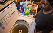 St. Joseph resident Rudy Shorts fills her washing machine to see if the water is usable and opts not to use it. Gov. John Bell Edwards made an emergency health proclamation on December 16, 2016, enabling a fast-tracked replacement of St. Joseph's water system after lead was found in the water.