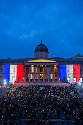 At the end the National Gallery and the fountains are bather in the colours of the Tricolour. Je suis Charlie/I am Charlie - A largely silent (with the occasional rendition of the Marseilaise)gathering in solidarity with the march in Paris today.  Trafalgar Square, London, UK 11 Jan 2015Guy Bell, 07771 786236, guy@gbphotos.com