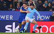 Ilkay Gundogan of Manchester City battles with Harry Maguire of Leicester city (l) .Carabao Cup quarter final match, Leicester City v Manchester City at the King Power Stadium in Leicester, Leicestershire on Tuesday 19th December 2017.<br /> pic by Bradley Collyer, Andrew Orchard sports photography.