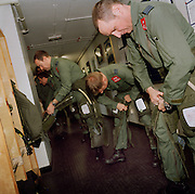 Pilots of the Red Arrows, Britain's RAF aerobatic team ready themselves before another training sortie.