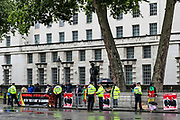 "Dozens of British-Cameroon political activists are protesting in Whitehall, nearby Downing Street prior to French President Emanuel Macron's visit in London, on Thursday, June 18, 2020. They say France is involved in the looting of Cameroon and Africa. A letter addressing the press and members of the public says: ""We are here to tell Mr Macron this is unacceptable. Enough is enough!"".<br /> For his first foreign trip since lockdown, Emmanuel Macron will be in London to mark the 80th anniversary of de Gaulle's « appel de Londres », as well as cement Franco-UK ties at a strained time due to Brexit. (Photo/ Vudi Xhymshiti)"