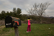 Young girl practices her baseball swing in Texana, NC.