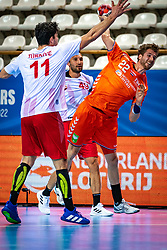 The Dutch handball player Jasper Adams in action during the European Championship qualifying match against Turkey in the Topsport Center Almere.