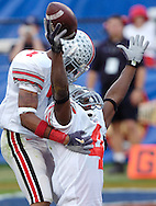 Santanio Holmes, right, holds his arms in the and is greeted in the end zone by teammate Ted Ginn after Holmes took a Troy Smith pass 85 yards for a touchdown yesterday in the second quarter.