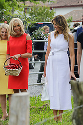 Brigitte Macron, wife of French President Emmanuel Macron, U.S. First Lady Melania Trump, stand in a field of Espelette pepper during a visit on traditional Basque culture in Espelette, near Biarritz as part of the G7 summit.August 25, 2019. Photo by Thibaud Moritz/ABACAPRESS.COM