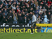 Photo: Andrew Unwin.<br />Newcastle United v Bolton Wanderers. The Barclays Premiership. 04/03/2006.<br />Newcastle's Nolberto Solano points to the badge as he celebrates scoring his team's first goal.