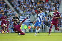 Football - 2017 / 2018 Premier League - Brighton and Hove Albion vs. Manchester City<br /> <br /> An acrobatic clearance by Vincent Kompany of Manchester City stop Davy Propper of Brighton a clear run on goal at The Amex Stadium Brighton <br /> <br /> COLORSPORT/SHAUN BOGGUST