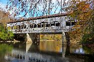 The picturesque Corwin M. Nixon covered bridge over the Little Miami River on an autumn day at Waynesville, Ohio, USA