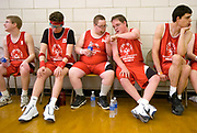 From left, Joseph Smith, James Hopp, Andy Ogg, Dylan Patterson and Jason Lambrix spend time on the bench during half time of their game in the 2009 Regional Basketball Tournament hosted by Area Nine Special Olympics Michigan at Handy Middle School on Saturday, March 7, 2009.