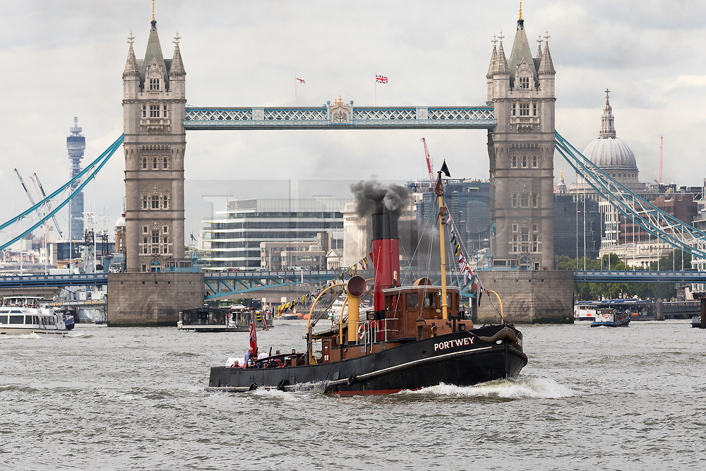 © Licensed to London News Pictures. 04/08/2017. LONDON, UK.  Steam Tug (ST) Portwey steams along the River Thames in London in front of Tower Bridge, travelling to Gravesend to take part in a series of events marking her 90th birthday, including a salute by Commander Richard Pethybridge at the Royal Navy's HMS President on the way. The ST Portwey was built on the Clyde in 1927, came under the command of the Royal Navy during the Second World War when she was based in Dartmouth and carried out rescues of vessels and crews sunk by enemy action in the Channel and is the only twin screw, coal fired steam tug still active in the whole of the United Kingdom.  Photo credit: Vickie Flores/LNP