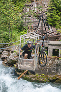Taking cable car over Carpenter Creek on the Galena Trail, New Denver, Slocan Valley, West Kootenay, British Columbia, Canada (MR)