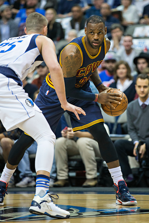 DALLAS, TX - JANUARY 12:  Lebron James #23 of the Cleveland Cavaliers with the ball while being guarded by Chandler Parsons #25 of the Dallas Mavericks at American Airlines Center on January 12, 2016 in Dallas, Texas.  NOTE TO USER: User expressly acknowledges and agrees that, by downloading and or using this photograph, User is consenting to the terms and conditions of the Getty Images License Agreement.  The Cavaliers defeated the Mavericks 110-107.  (Photo by Wesley Hitt/Getty Images) *** Local Caption *** Lebron James; Chandler Parsons