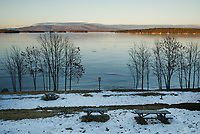 Lake Winnipesaukee with a smooth layer of ice out from Lincoln Beach into the Broads at dusk Monday following the flash freeze over the weekend.  (Karen Bobotas/for the Laconia Daily Sun)