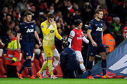 Man Utd Defender Nemanja Vidic (SRB) leads out gis side as Goalkeeper David De Gea (ESP) holds his head in his hand as the two teams walk out of the tunnel - Photo mandatory by-line: Rogan Thomson/JMP - 07966 386802 - 12/02/14 - SPORT - FOOTBALL - Emirates Stadium, London - Arsenal v Manchester United - Barclays Premier League.