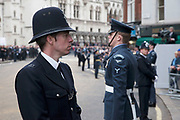 London Wednesday 17th April 2013. The funeral of former Prime Minister Baroness Margaret Thatcher. Metropolitan police on duty outside St Clement Danes Church prior to the funeral. Security was high with various layer of the armed forces and emergency services all on hand.
