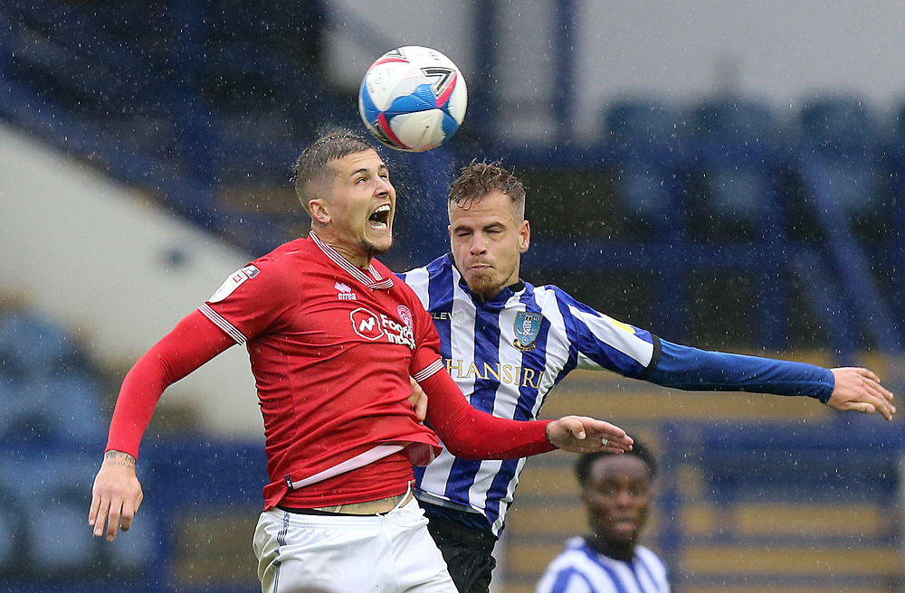 Queens Park Rangers' Lyndon Dykes vies for possession with Sheffield Wednesday's Joost van Aken<br /> <br /> Photographer Rich Linley/CameraSport<br /> <br /> The EFL Sky Bet Championship - Sheffield Wednesday v Queens Park Rangers - Saturday 3rd October 2020 - Hillsborough Stadium - Sheffield <br /> <br /> World Copyright © 2020 CameraSport. All rights reserved. 43 Linden Ave. Countesthorpe. Leicester. England. LE8 5PG - Tel: +44 (0) 116 277 4147 - admin@camerasport.com - www.camerasport.com