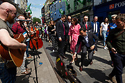 17/05/2019 MEP Candidate Maria Walsh got a big push from party leader and Taoiseach Leo Varadkar in Galway seen here with busker and Hildegarde Naughton  TD  as the team canvassed the town  with  the Galway 2020 Capital of Culture Logo on Shop street . Photo:Andrew Downes, Xposure