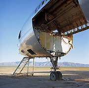 In mid-day heat of the arid Sonoran desert sits the gutted remains of a Lockheed Tri-Star airliner at the storage facility at Mojave, California. Here, the fate of the world's retired civil airliners is decided by age or a cooling economy and are either cannibalised for still-working parts or recycled for scrap, their aluminium fuselages worth more than their sum total. After a lifetime of safe commercial flight, wings are clipped and cockpits sliced apart by huge guillotines, cutting through the sleek curves. Elsewhere, Jumbo jets, Airbuses and assorted Boeings sit abandoned in the scrub minus their bellies, legs or wings like dying birds. Picture from the 'Plane Pictures' project, a celebration of aviation aesthetics and flying culture, 100 years after the Wright brothers first 12 seconds/120 feet powered flight at Kitty Hawk,1903.