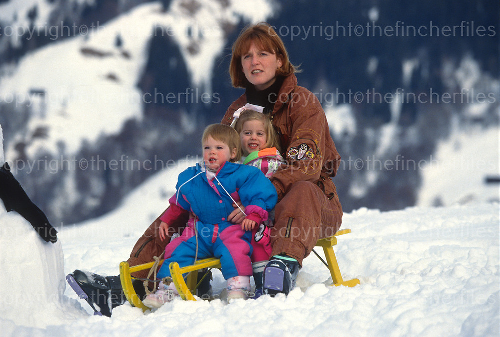 Sarah, Duchess of York seen with her daughters Princess Beatrice and Princess Eugenie during a ski holiday in Klosters, Switzerland in 1992. Photograph by Jayne Fincher