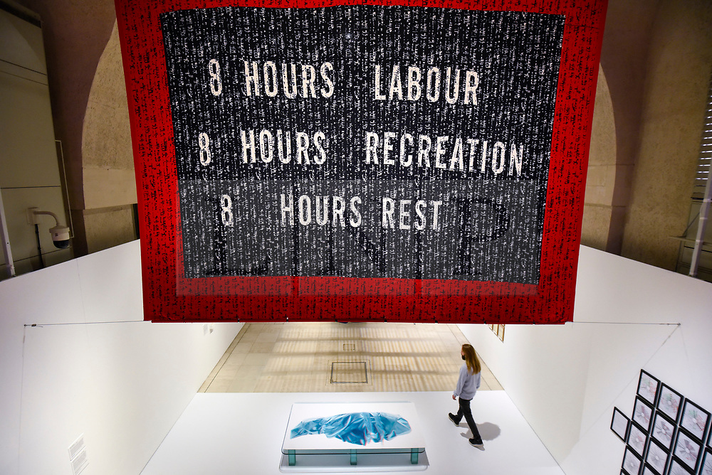 """© Licensed to London News Pictures. 29/10/2019. LONDON, UK. """"Punchcard Economy"""", 2013, by Sam Meech, a machine knitted banner made with digital imaging software. Preview of """"24/7: A Wake-Up Call For Our Non-Stop World"""", a new exhibition opening on 31 October at Somerset House.  The show examines our inability to switch off from our 24/7 culture.  Over 50 multi-disciplinary works explore the pressure to produce and consume information around the clock. taking visitors on a 24-hour cycle from dawn to dusk through interactive installations.  Photo credit: Stephen Chung/LNP"""