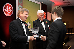CARDIFF, WALES - Wednesday, November 11, 2009: Wales' Aaron Ramsey is presented with the Young Welsh Player of the Year trophy by SA Brains' Chairman John Rhys and General Secretary David Collins during the Football Association of Wales Player of the Year Awards hosted by Brains SA at the Cardiff City Stadium. (Pic by David Rawcliffe/Propaganda)