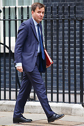 © Licensed to London News Pictures. 14/07/2015. London, UK. Chief Secretary to the Treasury, Greg Hands attending to a cabinet meeting in Downing Street on Tuesday, July 14, 2015. Photo credit: Tolga Akmen/LNP