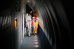 After having a cataract removed from his right eye, patient Meraz Sekh, 10, is accompanied by his mother, Ektara Bibi, and Orbis Lead Ophthalmologist Joanne Barleta down the hallway of the ORBIS Flying Eye Hospital.