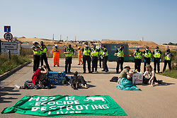 Environmental activists from HS2 Rebellion use lock-on arm tubes to block a gate to the South Portal site for the HS2 high-speed rail link on 14 September 2020 in West Hyde, United Kingdom. Anti-HS2 activists blocked two gates to the same works site for the controversial £106bn rail link, one remaining closed for over six hours and another for over nineteen hours.